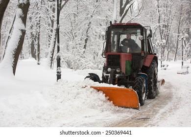 KIEV, UKRAINE - FEBRUARY, 5, 2015:  Snowplows in the park in city center during heavy snowfall