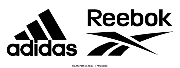 Kiev, Ukraine - February 8, 2017: Reebok and Adidas logos printed on paper and placed on white background.