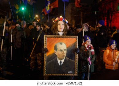 KIEV, UKRAINE - Jan. 01, 2018: Ukrainian nationalist activists mark the 109th birth anniversary of Stepan Bandera. Young woman with a portrait of Stepan Bandera