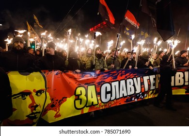 KIEV, UKRAINE - Jan. 01, 2018: Ukrainian nationalist activists mark the 109th birth anniversary of Stepan Bandera. Words on the poster - For the glory of heroes