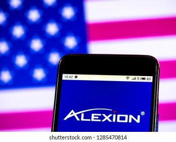 KIEV, UKRAINE - Jan 15, 2019:Alexion Pharmaceuticals company logo seen displayed on smart phone.