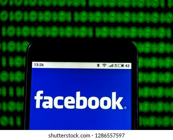 KIEV, UKRAINE - Jan 16, 2019: Facebook, Inc. Social network company logo seen displayed on smart phone