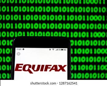 KIEV, UKRAINE - Jan 17, 2019: Equifax Consumer reporting agency company logo seen displayed on smart phone