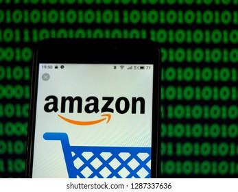 KIEV, UKRAINE - Jan 17, 2019:  Amazon.com E-commerce company logo seen displayed on smart phone