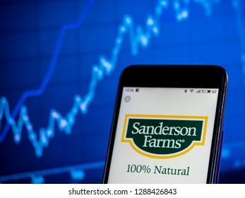 KIEV, UKRAINE - Jan 18, 2019: Sanderson Farms, Inc. Poultry farming company logo seen displayed on smart phone
