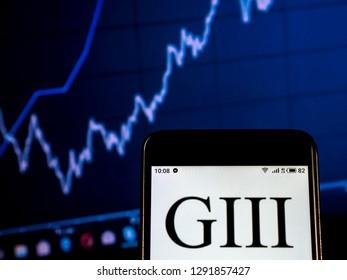 KIEV, UKRAINE - Jan 22, 2019: G-III Apparel Group Clothing company logo seen displayed on a smart phone