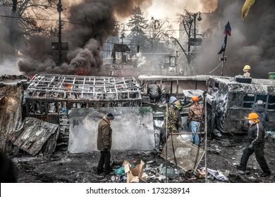 KIEV, UKRAINE - JAN 25, 2014: Mass anti-government protests in the center of Kiev. Barricades in the conflict zone on Hrushevskoho St.