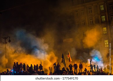 KIEV, UKRAINE - JAN 26, 2014: Euromaidan protesters rest and strengthen their barricades on Hrushevskoho Street after another night of clashes with riot police in Kiev, Ukraine.