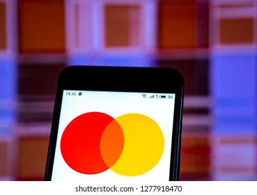 KIEV, UKRAINE - Jan 8, 2019: Mastercard new logo seen displayed on smart phone. The company explained the decision to change the logo of the growing volume of digital operations.