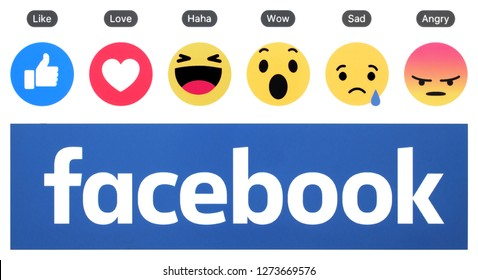 Kiev, Ukraine -  January 01, 2019: New Facebook logo with like button and Empathetic Emoji Reactions printed on white paper.