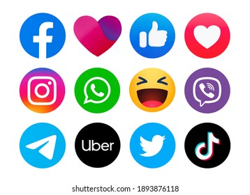 Kiev, Ukraine - January 11, 2021:  Set of most  popular social media logos printed on paper: Facebook, Instagram, Twitter, WhatsApp,  Facebook Dating App icon,Viber,Telegram, Uber, TikTok.