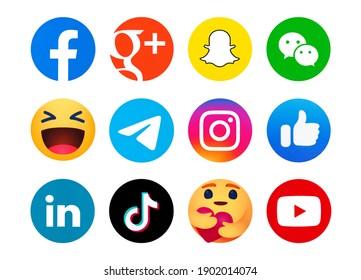 Kiev, Ukraine - January 11, 2021: Set of most  popular social media logos printed on paper: Facebook, Google Plus, Snapchat, WeChat, LinkedIn, Instagram, Telegram, Emoji reactions,TikTok, Youtube.