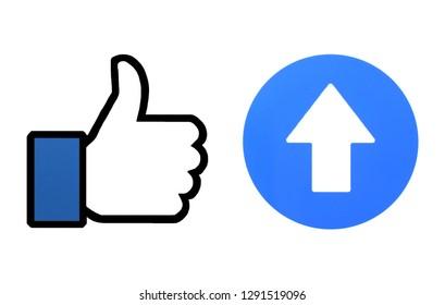 Kiev, Ukraine - January 14, 2019: Facebook like  and up arrow printed on paper.