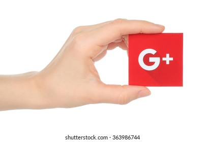Kiev, Ukraine - January 15, 2016:Hand holds new Google plus logotype printed on paper and cut, on white background.Google is USA multinational corporation.