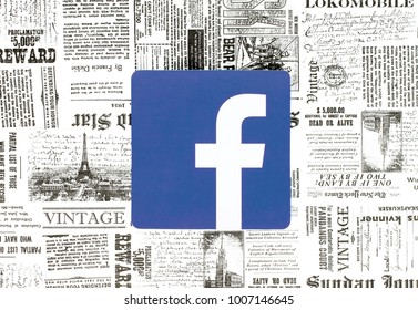 Kiev, Ukraine - January 15, 2018: Facebook icon printed on paper and placed on retro newspaper background