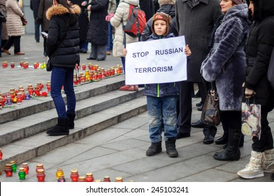 """Kiev, Ukraine - January 18, 2015: mourning at the Independence Square for the victims of the bus on the highway Volnovakha, Donetsk region. """"Je suis Volnovakva"""" demonstration"""