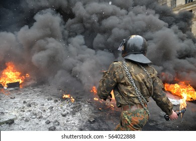 Kiev, Ukraine, January 22, 2014: Protesters set fire to tires and throwing stones at police and Molotov cocktails during the protests against President Yanukovych's policies. Kiev, street Grushevskogo