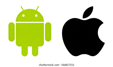 Kiev, Ukraine - January 22, 2017: Popular operating system logos printed on paper: Android and Apple.  Android - the operating system. Apple is an American corporation.