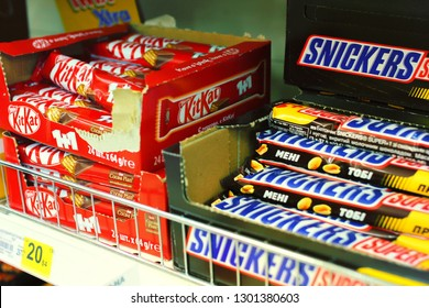 Kiev, Ukraine - January 22, 2019. Snickers and Kit Kat, a famous chocolate bars on shelves in the Auchan store. Kit Kat and Snickers are  famous brands of chocolates.