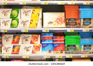 Kiev, Ukraine - January 22, 2019. Lots of boxes with cocolate candies on shelves in the Auchan store. Auchan is a network of supermarkets.