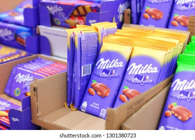 Kiev, Ukraine - January 22, 2019. Milka, a famous chocolate bar on shelves in the Auchan store. Milka is a famous brand of chocolates from Switzerland.