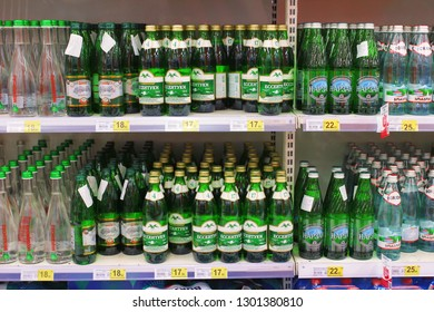 Kiev, Ukraine - January 22, 2019.  Lots of sparkling waters on shelves in the Auchan store. Auchan is a network of supermarkets.
