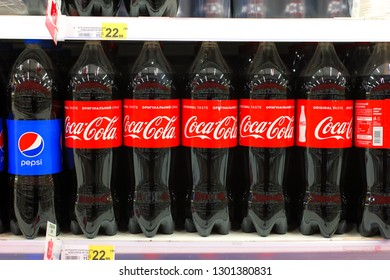 Kiev, Ukraine - January 22, 2019.  Lots of Pepsi and Coca Cola soda waters on shelves in the Auchan store. Pepsi and Coca Cola are the famous soda water manufacturers.