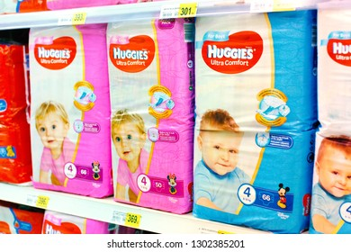 Kiev, Ukraine - January 22, 2019. Lots of diapers of Huggies brand on shelves in the Auchan store. Huggies is a famous brand of diapers.