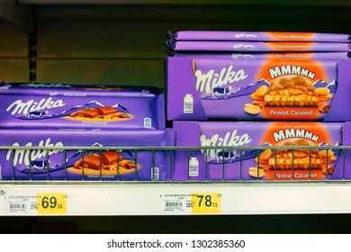 Kiev, Ukraine - January 22, 2019. Milka with peanut caramel, a famous chocolate bar on shelves in the Auchan store. Milka is a famous brand of chocolates from Switzerland.
