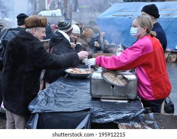 KIEV, UKRAINE - JANUARY 24, 2014: Unknown people prepare food for protesters on the revolution on January 24, 2014 in Kiev, Ukraine