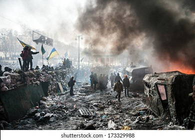 KIEV, UKRAINE - January 25, 2014: Mass anti-government protests in the center of Kiev. Barricades in the conflict zone on Hrushevskoho St.