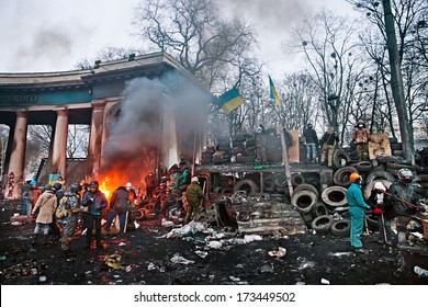 KIEV, UKRAINE - January 26, 2014: Euromaidan protesters rest and strengthen their barricades on Hrushevskoho Street after another night of clashes with riot police in Kiev, Ukraine.