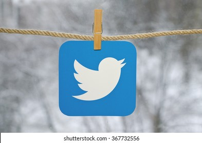 Kiev, Ukraine - January 26, 2016: Popular social media Twitter hanging on the clothesline, against the backdrop of a winter landscape.