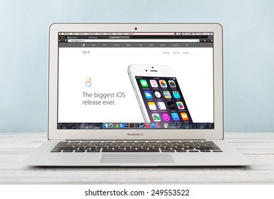 KIEV, UKRAINE - JANUARY 29, 2015: Brand new Apple MacBook Air Early 2014 with page presenting new iOS 8 on screen, designed and developed by Apple Inc., it was released on April 29, 2014
