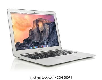 KIEV, UKRAINE - JANUARY 29, 2015: Studio shot of brand new Apple MacBook Air Early 2014 with home page on screen, designed and developed by Apple Inc., it was released on April 29, 2014