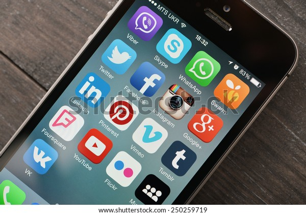 KIEV, UKRAINE - JANUARY 29, 2015: Social media icons on screen of smartphone. Social media are most popular tool for communication, sharing information and content between people in internet network.