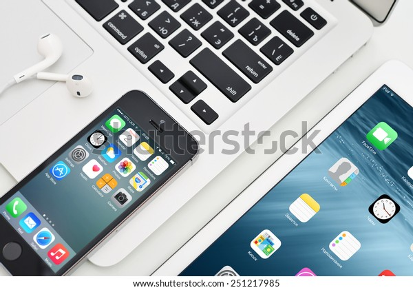 KIEV, UKRAINE - JANUARY 29, 2015: Apple iPhone 5s, iPad Air 2 and MacBook Air. Apple Inc. is an American multinational corporation that designs, develops, and sells consumer electronics.