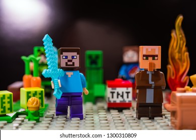 Kiev, Ukraine - January 30, 2019: Minifigure Steve with diamond sword and villager run away from the Creeper. Characters of the game Minecraft.