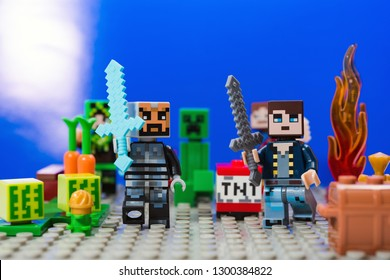 Kiev, Ukraine - January 30, 2019: Minifigure Iron man with diamond sword and Characters of the game Minecraft run away from the Creeper.