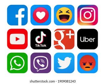 Kiev, Ukraine - January 31, 2021:  Facebook, YouTube,  Instagram, Viber, TikTok, Google Plus, Uber, WhatsApp,Twitter, Empathetic Emoji reactions printed on paper.