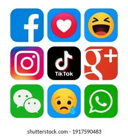 Kiev, Ukraine - January 31, 2021: Set of most  popular social media logos: Facebook, Instagram, TikTok, Google Plus, WeChat, WhatsApp, Facebook Empathetic Emoji reactions ,printed on paper.