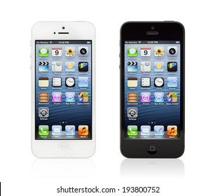 KIEV, UKRAINE - JANUARY 9, 2013: Two brand new black and white Apple iPhone 5, sixth generation version of the iPhone, designed and developed by Apple Inc., it was released on September 21, 2012.