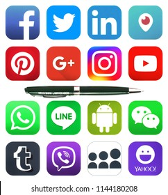 Kiev, Ukraine - JULE 28, 2018: Pen and collection of popular social network logos printed on paper: Facebook, Twitter, LinkedIn, Instagram, Line and others.