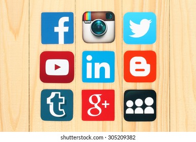 KIEV, UKRAINE - JULY 01, 2015: Famous social media icons such as: Facebook, Twitter, Blogger, Linkedin, Tumblr, Myspace and others, printed on paper and placed on wooden background.