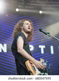 KIEV, UKRAINE - JULY 02, 2017: Rock band Sinoptik, winner Global Battle of the Bands 2016, and its frontman and guitarist Dmitriy Afanasyev performs live at the Atlas Weekend Festival in Expocenter.