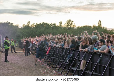 KIEV, UKRAINE - JULY 02, 2017: Young fans enjoy music concert outdoors at the Atlas Weekend music festival in National Expocenter.