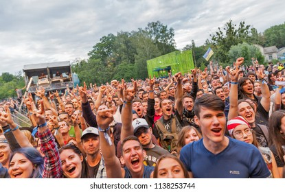 KIEV, UKRAINE - JULY 04, 2018: Fans crowd enjoy Dutch symphonic metal rock band Epica live performance at the Atlas Weekend Festival in National Expocenter.