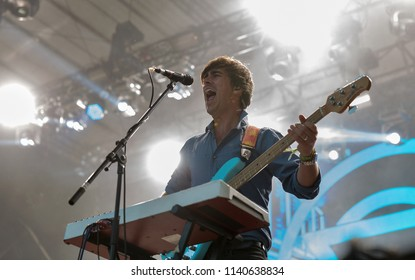 KIEV, UKRAINE - JULY 04, 2018: Enter Shikari, British alternative post hardcore rock band and Chris Batten, bass guitarist and percussionist performs live at Atlas Weekend Festival in Expocenter.