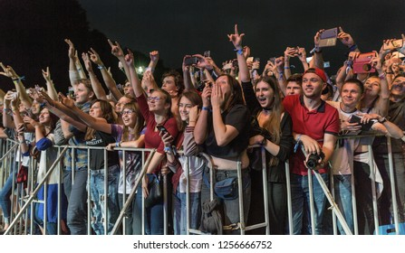 KIEV, UKRAINE - JULY 04, 2018: Fans crowd enjoy live heavy metal performance at the Atlas Weekend Festival in National Expocenter.