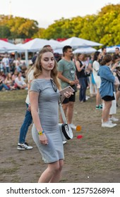 KIEV, UKRAINE - JULY 06, 2018: Young beautiful woman music fan with smartphone visits outdoor music concert at the Atlas Weekend music festival in National Expocenter.